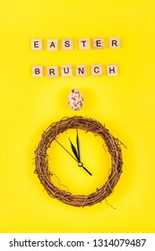 Creative Top view flat lay holiday composition Easter brunch nest egg text message on bold yellow paper background copy space Template Easter day seasonal minimal concept