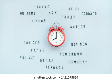 Creative top view flat lay of alarm clock with messages about delay or starting doing task copy space blue background minimal style. Concept of procrastination, time management in business and life
