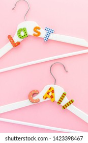 Creative top view flat lay white wooden hangers last call text pastel pink background with copy space minimalism style. Template fashion blog social media sale store promo design shopping concept