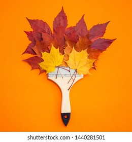 Creative Top view flat lay autumn concept composition. Paint brush dried bright autumn leaves paper background copy space. Square Template mock up fall thanksgiving wedding anniversary invitation card