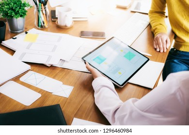 Creative UX UI designer teamwork meeting and planning to design the user interface wireframe layout of website and mobile application. Mobile and website design development technology.