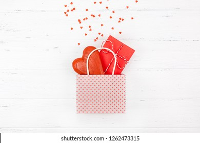 Creative Valentine Day romantic composition flat lay top view love holiday celebration with red heart white wooden background copy space Template greeting card text design social media blogs