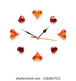Creative valentines concept photo of clock with hearts on white background.