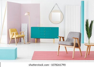 Creative, wooden furniture composition and color scheme idea for a modern, hipster living room interior with retro design elements