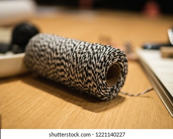 Creative Workplace: Desk with black and white thread and other creative supplies