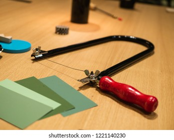 Creative Workplace: Desk different supplies like color palletes, yarn, saw and others