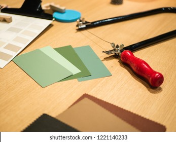 Creative Workplace: Desk different supplies like color palletes, fabric, saw and others