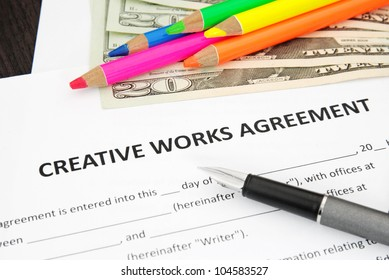 Creative Works Agreement with money dollar and crayons