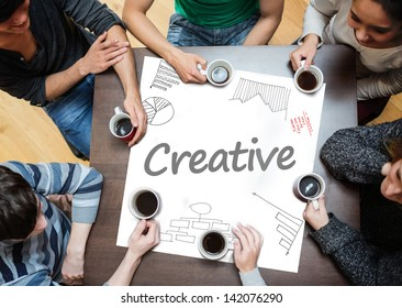 Creative written on a poster with drawings of charts during a brainstorm