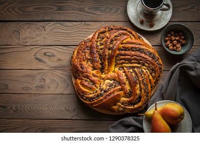 Creative yeast dough cake stuffed with pear, chocolate and hazelnuts.