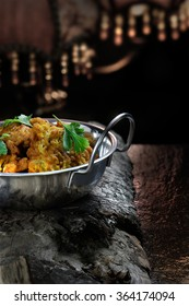 Creatively lit Indian Onion Bhajis against a dark, rustic styled background. The perfect image for your indian menu cover design. Generous accommodation for copy space.