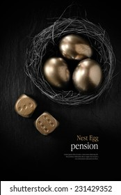 Creatively lit stylish concept image for pension nest egg or investment. Golden eggs placed in a birds nest with golden dice against black slate. Copy space.