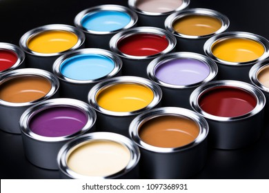 Creativity concept set of color brushes and can