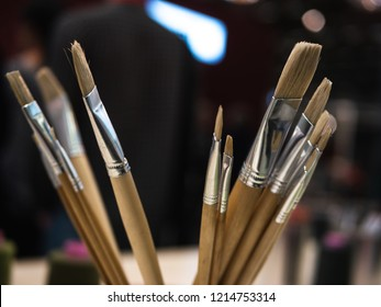 Creativity: Different paint brushes in a jar with blurry background