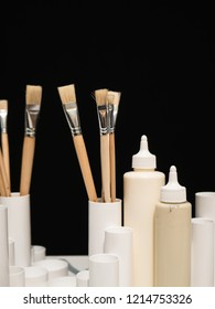 Creativity: Different paint brushes in a jar with black background
