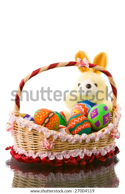 Creativity in elementary school arranging the Easter eggs in a nice basket with fat round bunny. It look so fun with them and have time to take a photograph