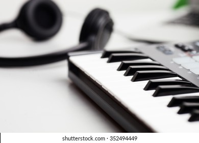creativity. headphones and keyboard. production of electronic music. Piano keyboard with headphones for music