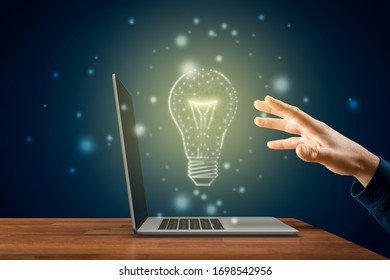 Creativity, idea and artificial intelligence concepts. Hands with notebook and graphics light bulb - symbols of idea, creative thinking, innovations and artificial intelligence (AI).