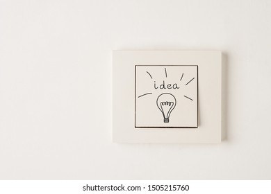 Creativity inspiration,ideas concepts with electric switch white wall background. Flat lay design