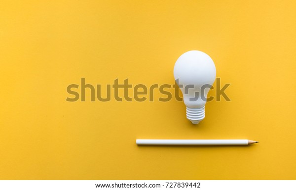 Creativity inspiration,ideas concepts with lightbulb and pencil on pastel color background.Flat lay design.