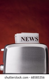 "Creativity on ""Hot News "". In the frame of a toaster and a news paper."