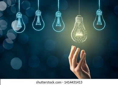 Creativity, visionary and innovation concept. Businessman pick light bulb (symbol of creativity and innovation) which is lightened.