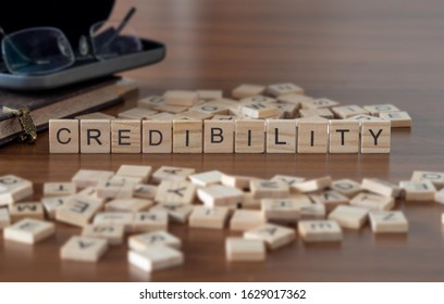 credibility concept represented by wooden letter tiles
