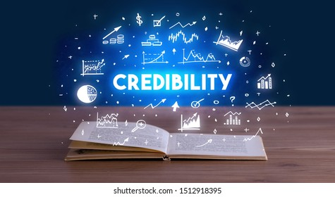 CREDIBILITY inscription coming out from an open book, business concept
