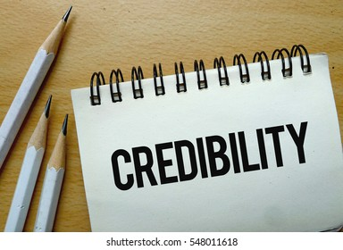 Credibility text written on a notebook with pencils