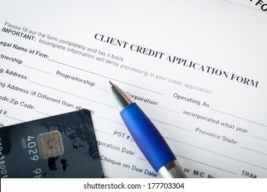 Credit application with pen and bank card