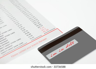 """Credit Card and Bank Statement showing debt with """"im in debt"""" signature on back of card,"""
