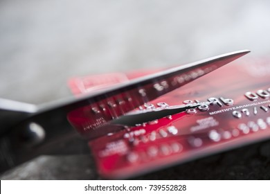 Credit card being cut with scissors, close up with copy space