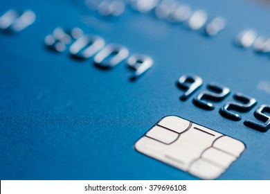 Credit card in blue with chip close up atm emv blurred