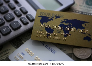 Credit card and calculator lying on big amount of US money closeup