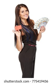 Credit card or cash. Smiling woman showing blank credit card and holding cash US dollars, over white background