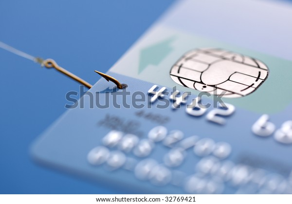Credit card caught on a fishing hook concept for addiction to spending with credit or phishing