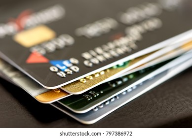 Credit card close-up. Plastic card on black background
