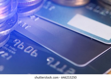 Credit card, coins and money on the table. business concept. shallow focus, soft tone.