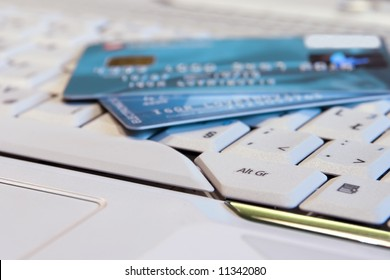 Credit card and computer. On-line shopping.