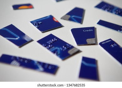 Credit card cut into pieces on a white background