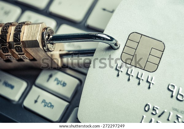 credit card data security - a security lock with a password and a credit card on computer keyboard