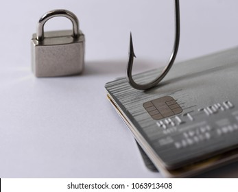 Credit card fraud, phishing, data security encryption concept - Credit card with blurred information and bait hook and key lock.