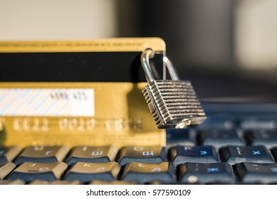 Credit card with hanging padlock on keyboard