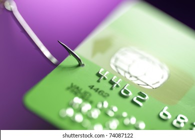 Credit card hooked on a fishing hook concept for addiction to spending with credit or internet phishing crime