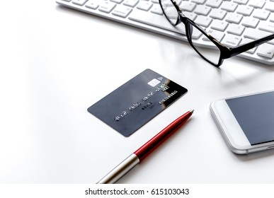 credit card, keyboard, smartphone and coffee cup on white backgr