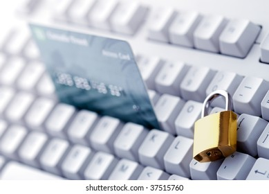 Credit card and lock on the keyboard.Financial security concept.