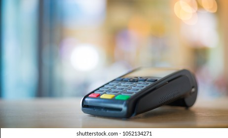 Credit card machine with blurred bokeh background
