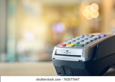 Credit card machine with bokeh background