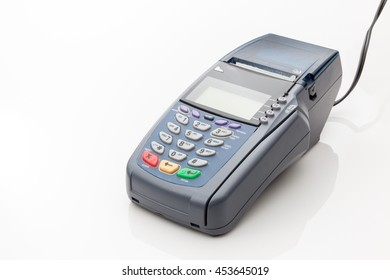 Credit card machine on a white background.