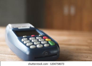credit card machine on the wooden table with nobody
